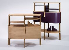 ETAGE is an item of furniture that has no equal. The two or three-level shelf is characterized by three features. The levels are shaped elegantly to form an oval, the supports have been positioned to make the concept of corners superfluous, and – making ETAGE entirely unique – the wrap-around shell can be moved vertically between levels, to either conceal or display – as desired.