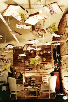 hanging books installation, fantasy, magical decor....bookcases to divide the reception and ceremony