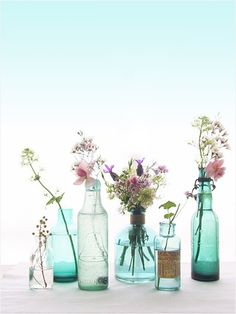 Colorful glass jars with wildflowers