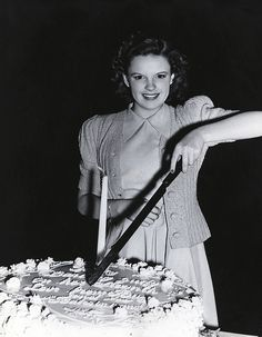 Judy Garland by cuts the cake