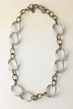 IN THE LOOP Necklace: Large loops, small links and different metal tones looks great alone or with a Charm Clip and charm. 19""