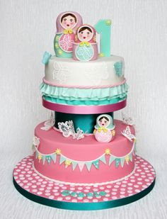 Russian Dolls and Butterflies Cake - Russian Dolls and Butterflies 1st birthday cake. My sister asked for an over the top, girlie Russian doll themed cake for my niece's 1st birthday