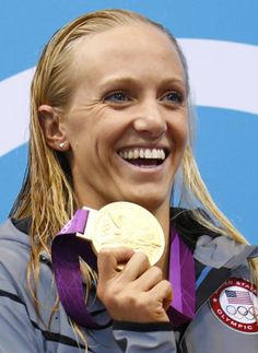 Dana Vollmer wins gold for USA in the 100 meter butterfly and sets a world record - London 2012