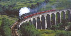 """The Jacobite Express [more famous for some as the """"Hogwarts Express""""] on Glenfinnan Viaduct, just outside the West Highland village of Spean Bridge, Scotland"""