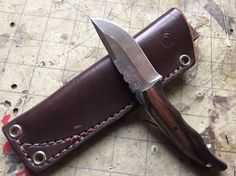 Damascus full tang with rosewood scales