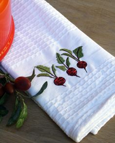 Beetroot embroidered tea towel. Size: 44cm x 65cm
