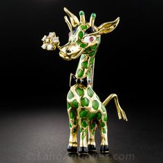 Ever dream of a green giraffe? Well your dream's come true! From mid-twentieth century Italy, he's all dressed up in black tie and (a real) tail with a sparkling diamond boutonniere (in his mouth)! Beautifully crafted in 18K yellow gold and colored in green, black and white enamel and ruby eyes. He stands a towering 2 and 3/8 inches tall.