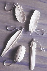 The Gilded Hare: diy clay feathers >> Simple and pretty!  all you need is some clay and a toothpick. start by taking a small piece of clay and flatten it in the shape you want your feather to be in.  trace where you want the center of the feather to be and pressed down everywhere else so that it is the only raised area.  then  use your toothpick and make lines down on either side.  the more lines you add the better it looks