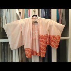 VTG Shibori Kimono Haori Jacket in Coral, One size Japanese Shibori Kimono Haori Coat, in coral, one size fits most.  Est 52 inches across arm to arm, 33 inches length neck to bottom.  Made of Kanoko Shibori Silk with lining. Kanoko Shibori is a technique of tie dye to give the pattern and puckering texture.  This coat can be worn with jeans (casual), over a traditional kimono, or a dress to give an elegant Japanese style evening out. Sometimes I wrap it over my sweats when I have guests…