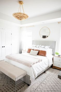 All white bedroom design has layers of texture and leather throw pillows for pops of color. The vintage style gold ceiling pendant is the showstopper in the room. Dream Bedroom, Home Bedroom, Modern Bedroom, Master Bedroom, Bedroom Decor, Airy Bedroom, Contemporary Bedroom, Guest Bedrooms, Guest Room