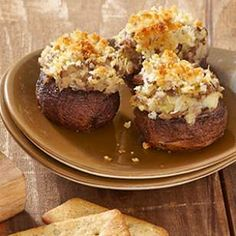 For this healthy stuffed mushroom recipe, marinated artichokes and Parmesan cheese are mixed with thyme and panko breadcrumbs for a delicious filling.