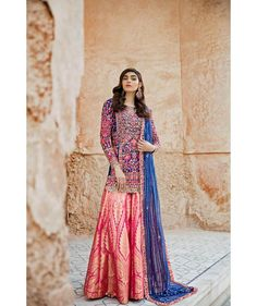 covered with beautiful red, coral and pink thread work lit up bright with detailed mirror work on top. The bright pink brocade dhakka pyjama is the minimal touch this rich look needed to allow it and its intricately bordered dupatta to shine Simple Outfits, Stylish Outfits, Cool Outfits, Designer Wear, Designer Dresses, Embroidered Kurti, Eid Outfits, Muslim Fashion, Indian Dresses