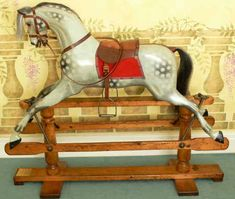 Edwardian Lines rocking horse restored by Classic Rocking Horses This pretty medium large size antique rocking horse is typical of the work of highly regarded makers, F.H. Ayres of London, and dates from the first quarter of the 20th century.