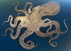 """Hand drawn aluminum Octopus, cut, shaped, and finished to create a 3 dimensional piece that looks great alone or as part of an underwater scene. Measures 30"""""""" across at it's widest point. This Octopus"""