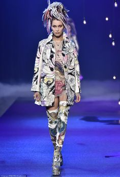 No can see:The girlfriend of The Weeknd showed off the sexy look backstage. But once onstage she covered up in a coat with hippie-style drawings on it that included flowers