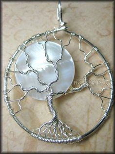 Under A Full Moon - Tree of Life Pendant in Sterling Silver Wire with White Pearl Shell (Winter) Original Design by Miss M. Turner. $50.00, via Etsy.