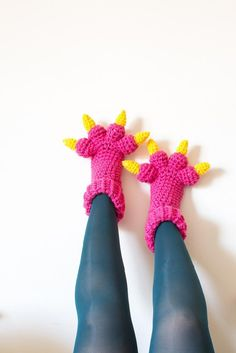Monster Slippers crochet pattern by Knits for Life. These fun slippers make a great halloween costume or just cozy treats to keep your toes toasty. Download the pattern at LoveCrochet.