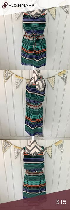 Merona Striped Tie Waist High Low Sleeveless Dress Sleeveless multi colored stripe Merona dress with a high low length, and an adjustable tie waist. Features a v-neck line, and a loose fitting top. Excellent used condition. The background color is black. Has side pockets! Merona Dresses High Low