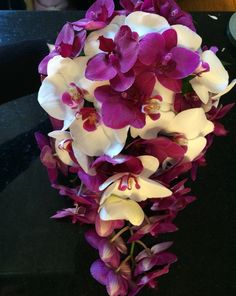 Brides bouquet in cerise pink and white orchids