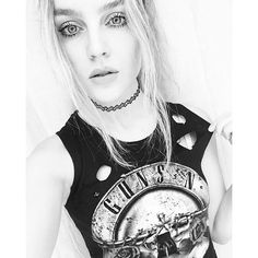 Perrie Edwards showed off her edgy band tee in a new black and white Instagram selfie. We love her Guns n Roses shirt and tattoo choker necklace.