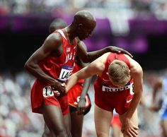 U.S. runner Bernard Lagat, left, and Galen Rupp make contact after competing in their Men's 5000m heat at the London 2012 Olympic Games.