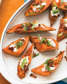 Loaded Sweet-Potato Skins Recipe -- garnish with bacon, paprika, and scallion, and cut in half to serve.