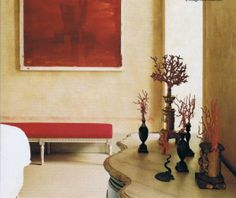 Louis XVI bench by Histoire de Sieges in a red silk bourette, vintage coral collection, bottom half of Boxer 3 painting by Julian Schnabel…House and Garden April '07. Image Trouvais