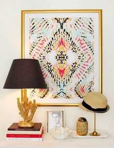 stacks of beautiful coffee table books are always great for accessorizing. love the lamp too
