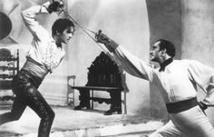 Tyrone Power and Basil Rathbone from The Mark of Zorro. Awesome version of Zorro! Zorro Movie, Movie Tv, The Mask Of Zorro, 1940s Movies, Tyrone Power, Sword Fight, Pose Reference, Sherlock Holmes, Classic Hollywood