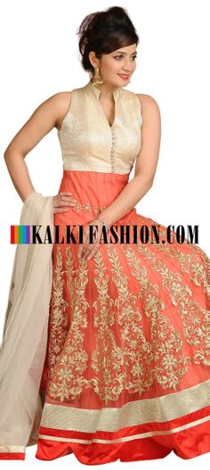 Buy Online from the link below. We ship worldwide (Free Shipping over US$100)  http://www.kalkifashion.com/peach-anarkali-suit-embellished-in-zari-embroidery.html