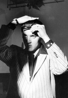 Elvis Presley fixing his hair backstage on the Milton Berle Show, June 5, 1956.
