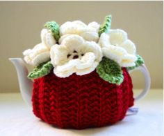 A personal favourite from my Etsy shop https://www.etsy.com/listing/206808473/hand-knitted-floral-tea-cosy-in-pure