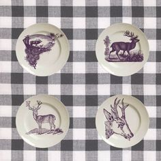 Decorate: pretty printed deer plates on a plaid tablecloth