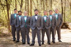The groomsmen added nice contrast with their teal bow ties and vests coordinating perfectly. #graygroomsmensuits #whaththegroomandgroomsmenwear @Vecoma at the Yellow River