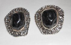 Vintage Earrings 1950s Signed Judy Lee southwestern silver tone metal black acrylic clip on This is a pair of earrings 1950s Designer costume jewelry clip ons. Late Mid century signed Judy lee in Script. They are a silver tone metal with black acrylic that looks like rock. The earrings are in very good vintage condition with the backs having a patina beginning. The earrings are lightweight and comfortable. The earrings measure 1 1/4 inches by 1 1/4 inches. Judy Lee by notdomesticated on Etsy