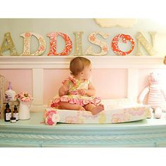 Love the molding with the name sitting on top. Maybe for Mia's new room