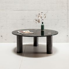 a_coffeetable01 | The combination of geometric shapes that comprise this coffee table will add a modern touch to any living space. The cylindrical, untreated steel legs provide a strong base for the circular black glass tabletop. Artistic as well as sturdy and practical, this table has both a contemporary and timeless look. Black Glass, Custom Furniture, Timeless Design, Geometric Shapes, Contemporary, Modern, Tabletop, Living Spaces, The Creator