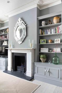 When a room looks dark and with no focus, add a fireplace to bring a centre. Alcove Ideas Living Room, Built In Shelves Living Room, Narrow Living Room, Living Room Grey, Living Room Interior, Home Living Room, Living Room Designs, Living Room Cupboards, Cozy Living