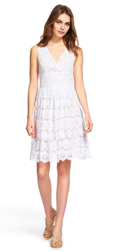 Adrianna Papell embroidered floral medallion lace dress   Greet warming temperatures in a new lace dress. This short dress features a chic mix of medallion and floral lace embroideries in white over a nude lining for a fresh take on a simple design. A wrap-style v-neckline and v-back make this dress even more worthy of a day in the sun. A subtle waist detail creates a flattering look for this fit-and-flare dress style.