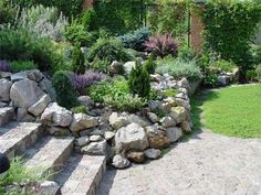 Beautiful rock garden design with natural stone wall, adds nice enclosure to the stairs an enables Raised Flowers (Christopher Alexander pattern) rock garden landscaping Garden Design, Backyard Landscaping, Natural Stone Wall, Rock Garden Design, Garden Decor, Backyard Garden, Outdoor Gardens, Landscaping With Rocks, Garden Stones