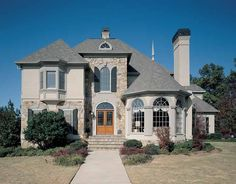 French Country House Plan with 3396 Square Feet and 4 Bedrooms from Dream Home Source | House Plan Code DHSW42448