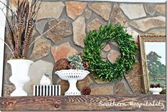 My Fall mantel using natural elements and white pottery. #Fall #mantel