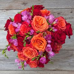 BBQ'N Volcano Collection | The Bouqs | $40 - $70 | Red and Orange Roses and Freesia accents make a beautiful bouquet.