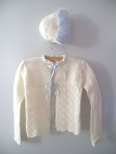 Vintage hand-knit baby sweater and bonnet, 1950's.