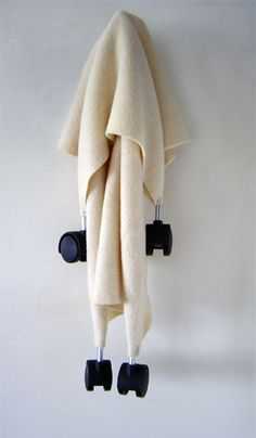 """""""Auxilary"""", Tom Dale, 2006 (blanket and caster wheels, 35 x 17 x 6 cm)"""