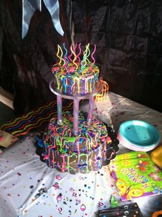 Glow Stick Birthday Party Ideas | Alex's 13th birthday cake. Stick glow sticks in the clear columns for ...