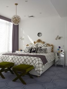 Jonathan Adler, love the gilded headboard and funky chandelier, along with mix of patterns
