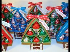 Learn how to make a Christmas Tree out of card stock and Hershey's Kisses and Hershey's Nuggets. This tutorial uses scoring to create the Christmas tree. For...