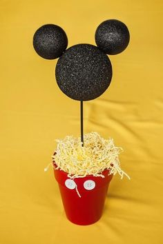 Mickey Mouse party decorations Would be cute to put yellow jelly beans or favors inside pot