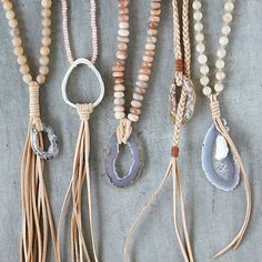 We love the sliced geodes that sparkle in the sun, especially when they're paired with summer leathers and beads. See how our stylist wear e